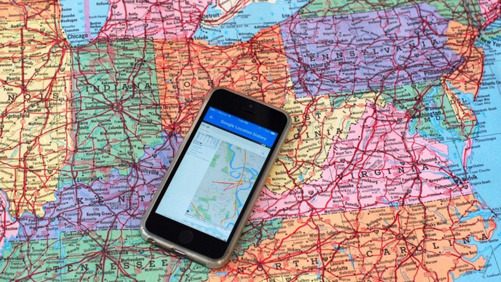 Phone placed on map of the US to represent Google location tracking